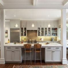 Small Open Galley Kitchen half wall turned counter seating: wit seating reversed to the