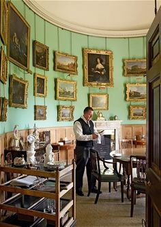 Goodwood House in pictures ~ private deining room situated in one of corner towers, Monty the butler lays the table for lunch.  The room's pictures include small landscapes by Canaletto.
