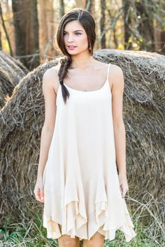Hello Gorgeous! The perfect, free spirit dress with handkerchief hemline! Love! Spring perfect! Must have, ivory sundress!