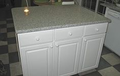 DYI kitchen island made of 2 prefab cabinets with dry erase board on the back and counter
