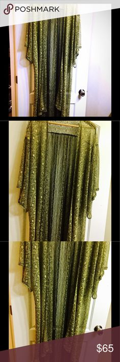sparkly gold black sheer crocheted long kimono This listing is for a gold and black sheer Finley crochet lace like long open front kimono, size medium fits a small and a large as well it's very universal in size no tag I cut it off because it was itchy but I bought this at a boutique in Hawaii super flowy and flouncy, looks like lace, it's mostly gold but has black undertones, super super unique and pretty, words can not describe this kimono. boutique Sweaters Shrugs & Ponchos