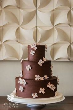 www.sylviaskitchen.co.uk three tiered sharp edged Belgian chocolate ganached wedding cake at The Old Rectory Hastings image by Katie Rogers Photography