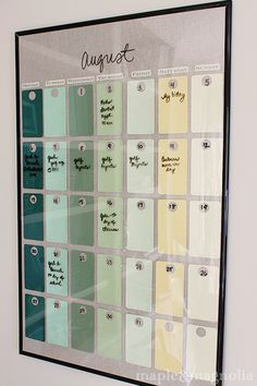 Prepare colorful paint chip and big frame to make modern wall organizer/calendar