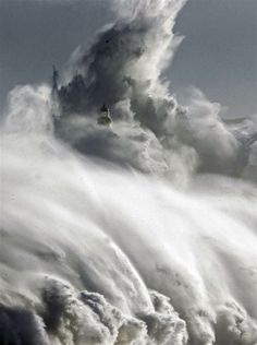 Large waves almost cover the lighthouse in Mouro island in front of port in Santander, northern Spain, 2/2/2014 (NBC News)