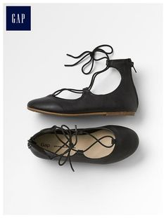Lace-up ballet flats are really in right now, but if you want something that's easier to slip on and off, go for flats that rise up higher on the ankle and have a zipper!