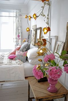 Beautiful white bedroom with girly glamorous pink pop of accent colour and lovely floral fairy lights. Bedroom Inspo, Bedroom Inspiration, Bedroom Decor, All White Bedroom, Master Bedroom, Blue Fairy Lights, Headboard With Lights, Color Pop, Colour