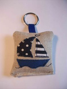 Sail boat key ring, maybe I could change the boat to a car Freehand Machine Embroidery, Free Motion Embroidery, Felt Fabric, Fabric Scraps, Felt Crafts, Crafts To Make, Sewing Crafts, Sewing Projects, Diy Keychain