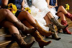 Bride and bridesmaids wearing cowboy boots.