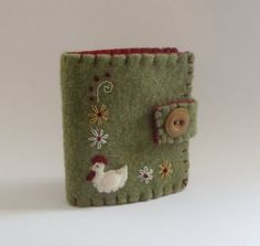 This adorable little needlebook was all hand stitched, embroidered, and appliqued using the teeniest pieces of felt and even teenier stitches! Felted Wool Crafts, Felt Crafts, Fabric Crafts, Sewing Crafts, Sewing Projects, Sewing Kits, Needle Case, Needle Book, Needle Felting