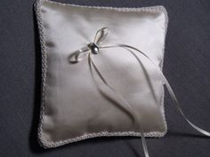 Ring pillow-handmaiden from silk satin with embroidered trim and Rhine stone accent. www.alterationsavenue.com