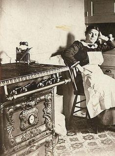 Victorian woman in her kitchen