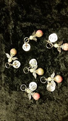 Angel Charms made from dried flowers.