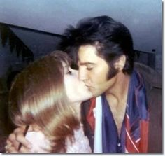 Elvis Australia club member, Mickie M. Malbrough being kissed by Elvis, after she thanked him for the photo(s)