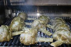 Summertime is for grilling ~ Add a filet, a glass of Cabernet, a sunset to these artichokes ... and you're set for a golden evening.  This recipe by Rutherford Grill in CA - HF Coors manufactures their platters with logo.  Bon appetite