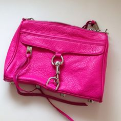 Rebecca Minkoff Mini MAC Neon pink or fuchsia  colored. Bought from another posher. Used and loved. Still in really good condition. The leather is amazing quality. Gets more beautiful with wear. Has signs of wear and tear on the little spots in pics but not obvious. (Final Sale. Buyer understands used condition and accepts and buys as is.) Rebecca Minkoff Bags