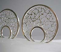 """Domed Ring"""" SARAH CILIA-UK """"Fine soldering creates my wire swirls which form my 18ct, 9ct yellow gold and silver jewellery. Embossed porcelain and jasper is encased in silver which creates brooches, pendants and earrings. """""""