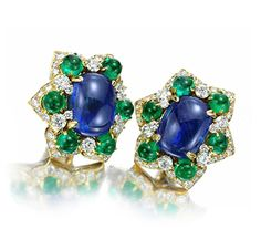 A Pair of Sapphire, Emerald and Diamond Ear Clips, by Bulgari, circa 1960. Via FD Gallery, www.fd-inspired.com