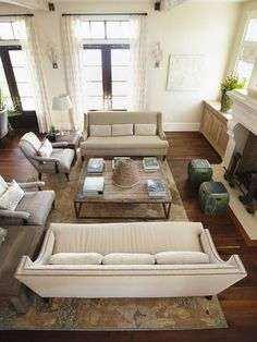 Urban grace interiors Love the two sofas and two chairs arrangement.