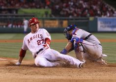 Game #54 6/2/12: Mike Trout #27 of the Los Angeles Angels of Anaheim slides safely past the tag of catcher Yorvit Torrealba #8 of the Texas Rangers in the seventh inning at Angel Stadium of Anaheim on June 2, 2012 in Anaheim, California. The Angels defeated the Rangers 3-2. (Photo by Jeff Gross/Getty Images)