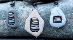 Stone pendants - small stones stacked inside larger stone. Cape Cod beach stone jewelry by KEM Designs