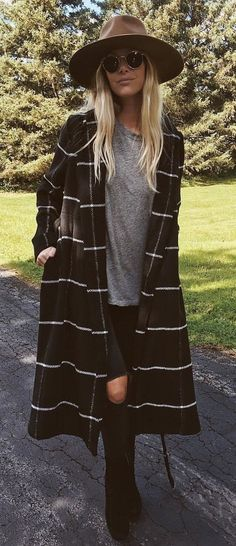 awesome fall outfit / hat + plaid coat + top + rips + boots