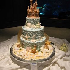 I always related to Princess Ariel, so my wedding will reflect my Disney Dream. It's the ultimate fantasy. This is my ocean/beach sand castle wedding cake Sand Castle Cakes, Castle Wedding Cake, Wedding Cakes, Little Mermaid Wedding, Little Mermaid Cakes, Wedding Sand, Dream Wedding, Wedding Veils, Summer Wedding