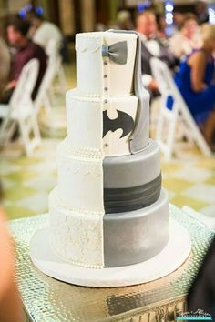 An elegant way of mixing the bride and groom's styles in a wedding cake #batman