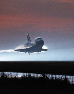 "The orbiter Columbia glides in for a dawn landing at Kennedy Space Center's Shuttle Landing Facility on December 7, 1996. STS-80 deployed and retrieved two research satellites: the Orbiting and Retrievable Far and Extreme Ultraviolet Spectrometer-Shuttle Pallet Satellite II (ORFEUS-SPAS II) ultraviolet observatory and the disk-shaped Wake Shield Facility-3 (WSF-3), which grew semiconductor films inside an ""ultra-vacuum"" environment."