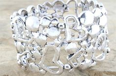 9800 Metal heart bracelet  £25.00 incl tax  Stunning, elasticated, metal heart bracelet.   Width - 4cms.