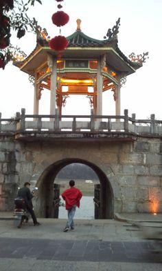 Yangshuo, China--a man contemplates the Li River through a tunnel underneath a Pagoda.