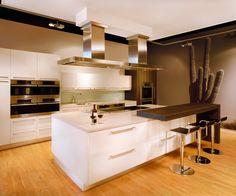 White Cabinets, Cream Countertops, Glass Backsplash, Warm Wood Flooring
