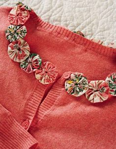 Yo-yos can become enchanting accents for your favorite accessories — they'll also liven up your living space. Sew them to kitchen curtains and pillows, or glue them to a terra-cotta flowerpot for an extra bit of bloom.    Read more: Mothers Day Crafts - Country Living