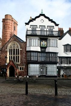 Mol's Coffee House, Exeter, England. Said to have been a coffee house since 1596. According to legend Sir Francis Drake discussed battle plans for defeating the Spanish Armada at Mol's, and his family crest is displayed on the oak panelling on the second floor.