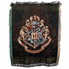One of my favorite discoveries at HarryPotterShop.com: Harry Potter Exclusive Hogwarts Crest Tapestry Throw  I WANT THIS FOR CHRISTMAS!!!!