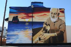 Mural artist Frank Styles with his work in Hastings Road, Hendon