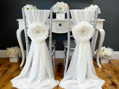 Event designer Dela Shehu creates these plush fabric flowers and chair sashes by hand and sells them at her Etsy shop, Dela Design Studio. The ten-inch flowers are created from layers of chiffon and anchored with a rhinestone button.