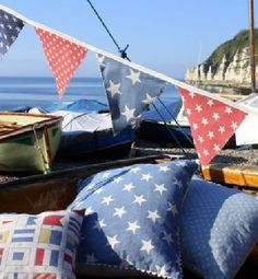 Sarah Hardaker - Stars Fabric Collection - Red, white and blue bunting with a semaphore print cushion, a blue and white star print cushion and a blue and white polka dot cushion Blue Cushions, Printed Cushions, Throw Cushions, Curtains Made Simple, Custom Made Curtains, Fabric Blinds, Curtains With Blinds, Curtain Fabric, Buy Fabric