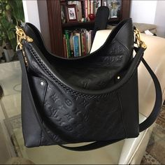 Louis Vuitton Black Leather Bagatelle Louis Vuitton Black Monogram Bagatelle in sensual, supple leather is the incarnation of causal chic thanks to its intricate braided handle and hobo bag shape. Very versatile, it can be carried in the hand, on the elbow, or over the shoulder. ❤️ Louis Vuitton Bags Shoulder Bags