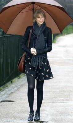 black on black on black under brown?  black tights, pattern skirt, leather jacket, brown umbrella