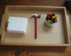 Mini hammer and TEE'S into foam - great activity! We have these at our preschool and they're covered in burlap, which helps contain the foam bits.