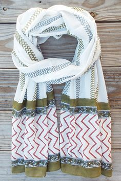Description A lightweight cotton hand block printed striped scarf in blues, greens and Marsala. - Hand blocked stamped with natural, plant based dyes - 100% Vegan - Fair trade & made in India - Design