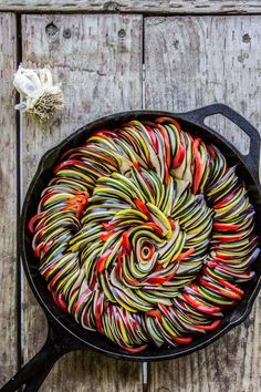 Roasted Garlic Ratatouille from The Food Charlatan // Tons of flavor! Roasted garlic sauce is covered in paper-thin spiced vegetables. This would be perfect for an impressive summer dinner or appetizer!