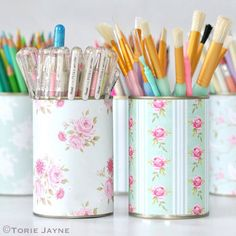 Keep the cans from canned foods, and wrap them in dollar store craft paper. Store your office supplies, like pens and pencils, in a cute and organized way. Get the tutorial at Torie Jayne.