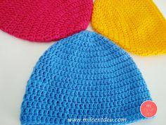 Gorros en ganchillo de color rosa, amarillo y azul. Crochet para el invierno.
