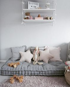This space has a small mattress and a few cushions and that's it. But it's still so inviting and a great little space for any kid to have https://petitandsmall.com/5-ways-create-cozy-corner-kids/