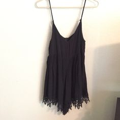 Tobi Black Romper Toni Black Babydoll romper embellished with lace on bottom. So cute. Worn once for country concert (see pics) looks like a dress when worn, but comfort of a romper. Super flattering. Size small Tobi Tops