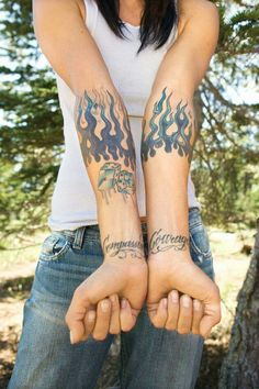 Arm Tattoos - Tattoo designs: Blue and purple flames encircle both forearms. Lettering on the wrist reads 'Compassion' and 'Courage'. Back Tattoos, Wrist Tattoos, Small Tattoos, Sleeve Tattoos, Cool Tattoos, Tatoos, Flame Tattoos, Tattoo Now, Tattoo Removal