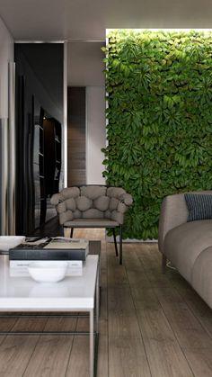 canapé et fauteuil design gris, plancher et mur végétal intérieur