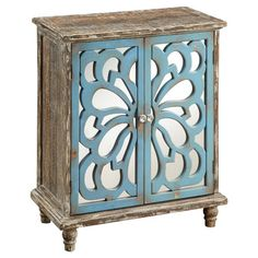 Distressed wood accent chest with 1 shelf behind 2 mirrored doors with a floral-inspired cutout overlay.  Product: Chest