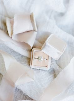 Cushion cut with halo setting in a blush the Mrs. Box: Photography: Julie Paisley Photography - juliepaisley.com   Read More on SMP: http://www.stylemepretty.com/2016/10/06/classic-traditional-yale-university-wedding/